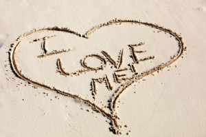 Heart drawn in sand with a most sincere message written inside of it proclaiming my undying love to myself.